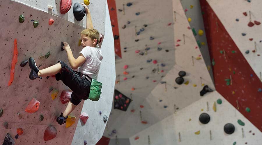 boy climbing indoors